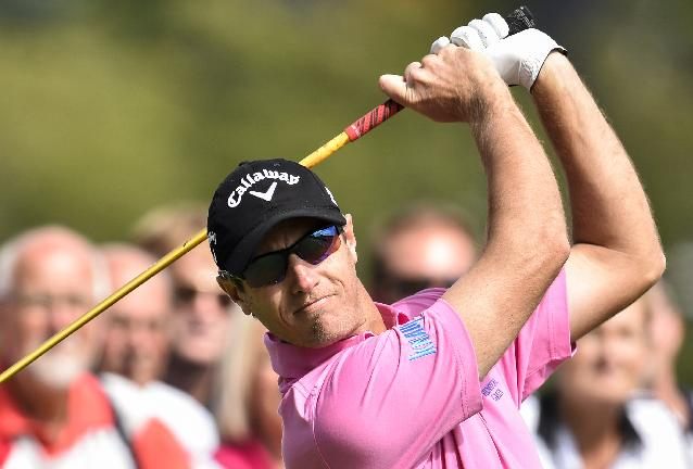 Nicolas Colsaerts from Belgium follows his shot during the second round of the European Tour Golf Tournament in Himmerland, Denmark, Friday, Aug. 15, 2014