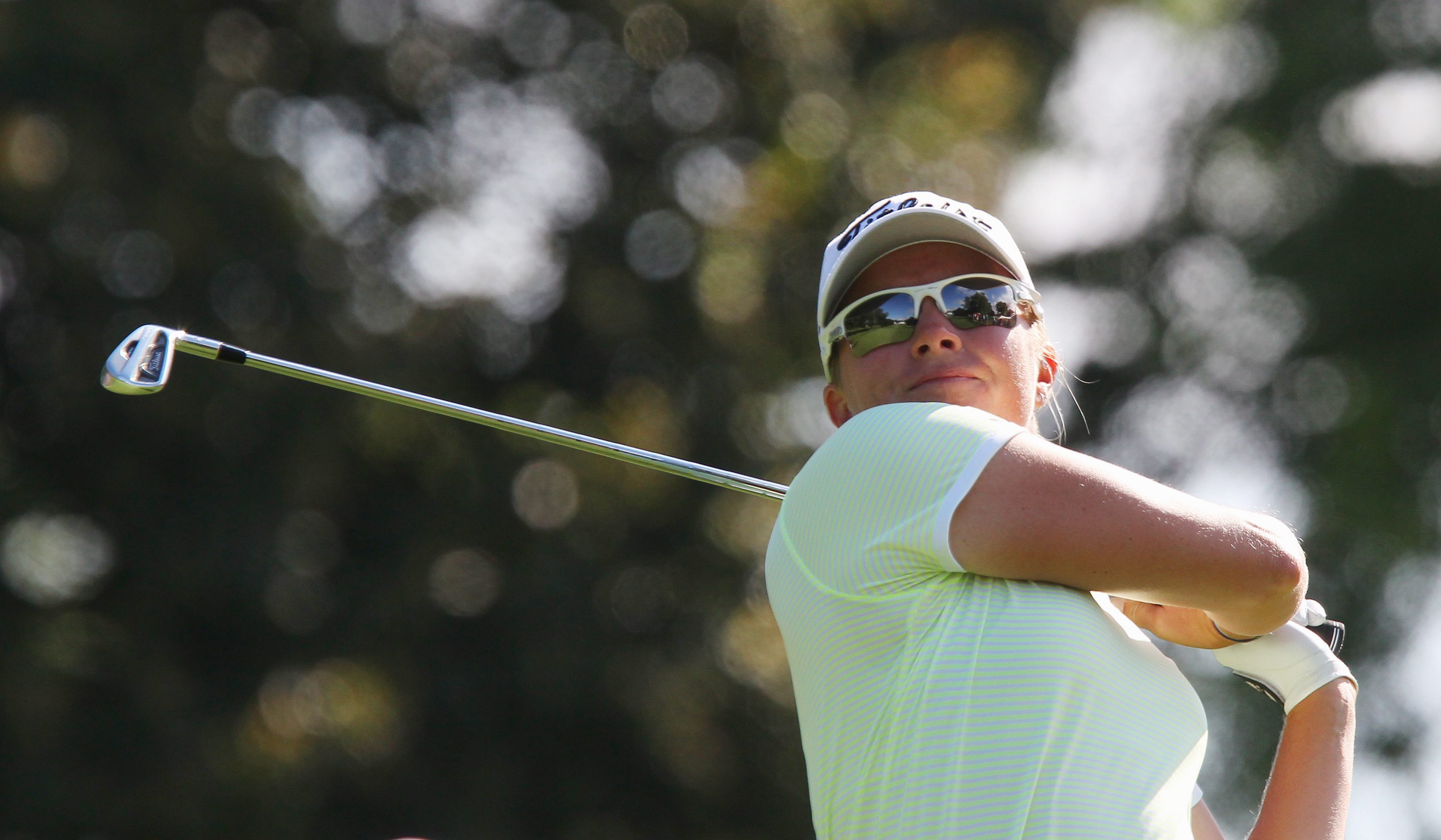 Alena Sharp, of Canada, hits her tee shot on the 17th hole at the Canadian Pacific Women's Open golf tournament in London, Ontario, Thursday, Aug. 21, 2014