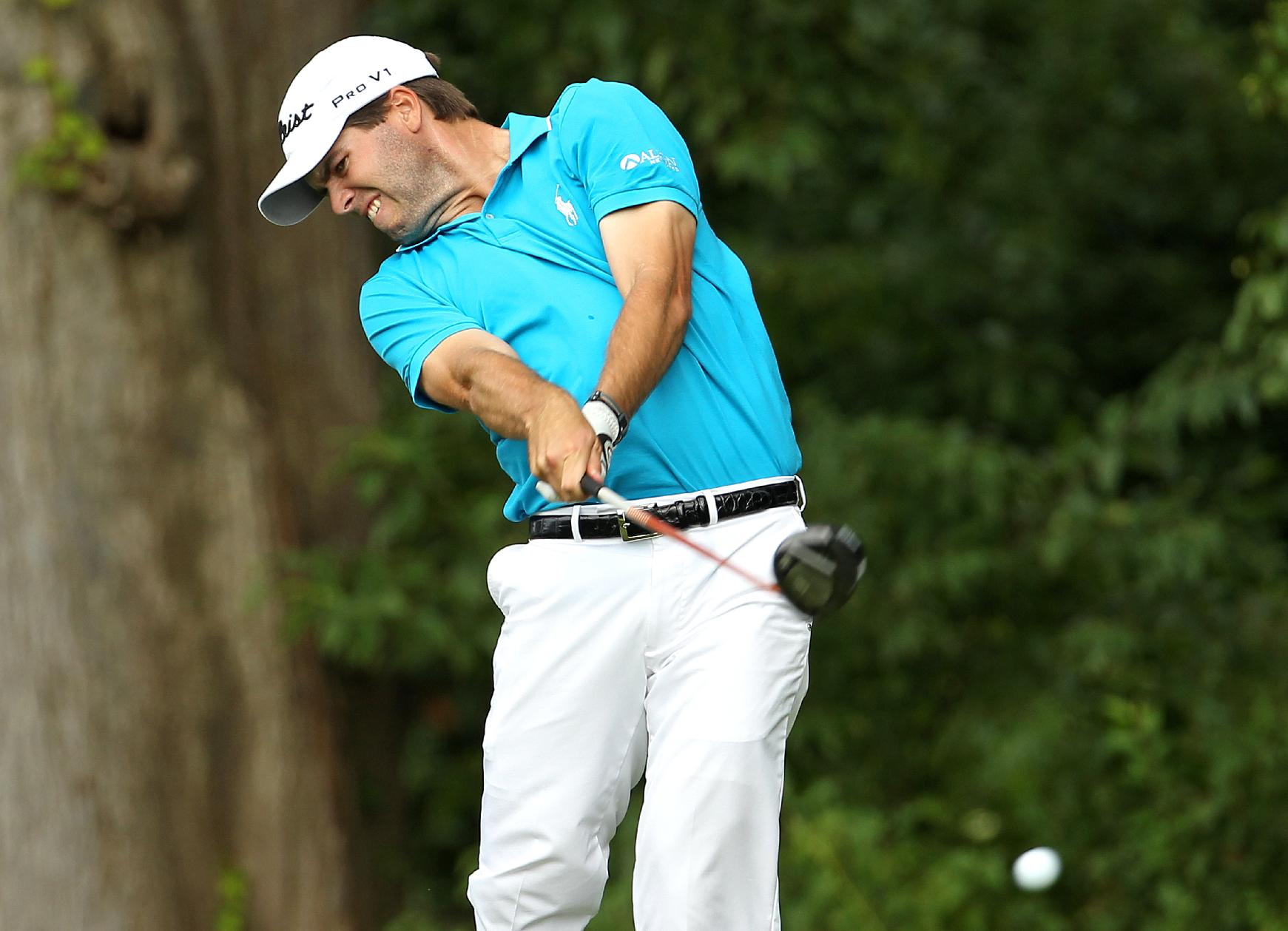 Ben Martin tees off on the fourth hole during first-round play at The Barclays golf tournament Thursday, Aug. 21, 2014, in Paramus, NJ