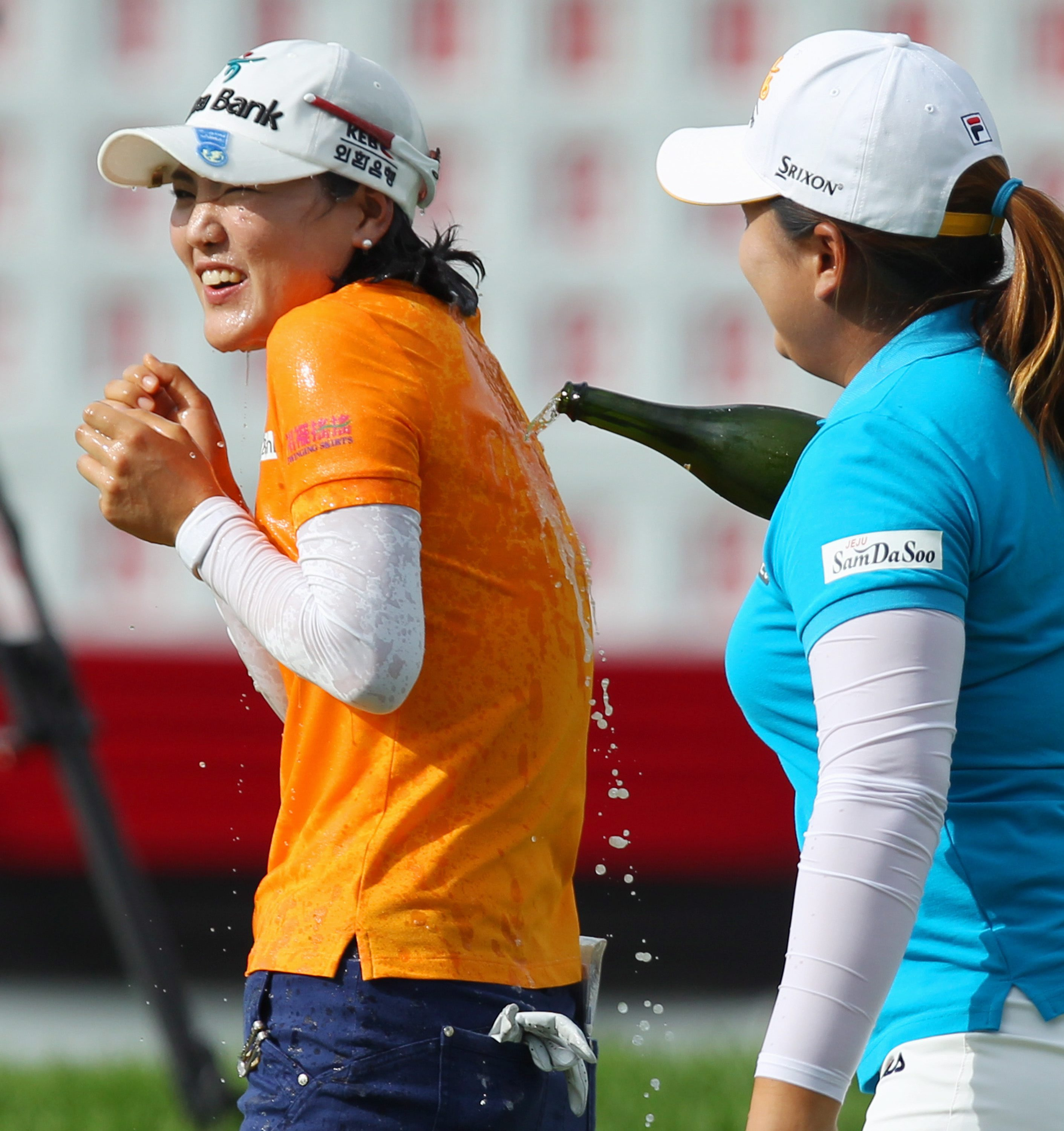 So Yeon Ryu, left, of South Korea, is doused by compatriot Inbee Park as she celebrates after winning the Canadian Pacific Women's Open golf tournament in London, Ontario, Sunday, Aug. 24, 2014