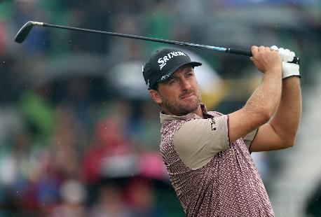 Graeme McDowell of Northern Ireland plays his shot from the 4th tee during the third day of the British Open Golf championship at the Royal Liverpool golf club, Hoylake, England, Saturday July 19, 2014