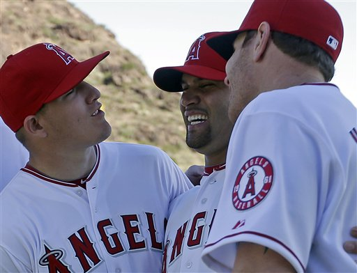 Mike Trout jokes with Albert Pujols and Josh Hamilton during a photo shoot. (AP)