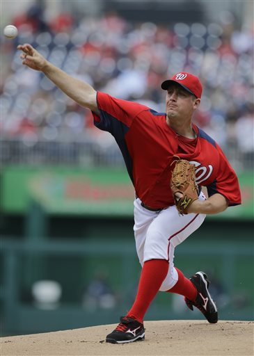 Washington Nationals starting pitcher Jordan Zimmermann throws during the first inning of an exhibition baseball game against the New York Yankees at Nationals Park Friday, March 29, 2013, in Washington