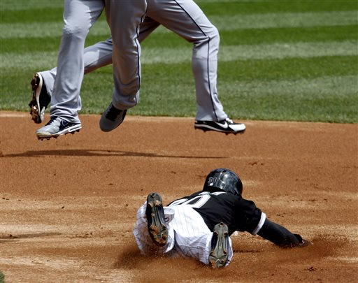 Chicago White Sox's Alejandro De Aza (30) steals second as Cleveland Indians second baseman Jason Kipnis, left, catches a high throw from Lou Marson, as shortstop Mike Aviles, background, runs behind during the first inning of a baseball game Wednesday, April 24, 2013, in Chicago