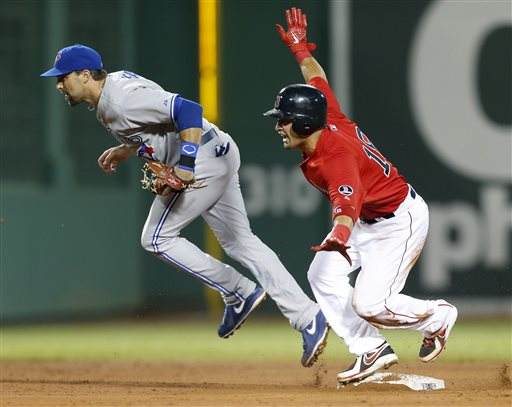 Toronto Blue Jays' Mark DeRosa, left,, comes off second base after failing to get the forced out on Boston Red Sox's Shane Victorino, right, in the fifth inning of a baseball game in Boston, Friday, May 10, 2013