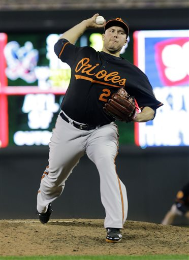 Baltimore Orioles pitcher Tommy Hunter throws against the Minnesota Twins in the ninth inning of a baseball game Friday, May 10, 2013 in Minneapolis. Hunter picked up the win as the Orioles won 9-6 in 10 innings