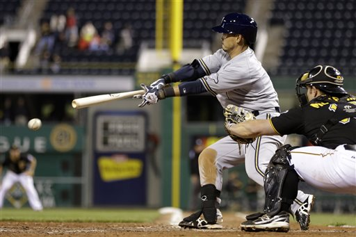 Milwaukee Brewers'  Norichika Aoki (7) drives in a run in the ninth inning with single off Pittsburgh Pirates relief pitcher Tony Watson (44) during a baseball game in Pittsburgh Monday, May 13, 2013. Aoki went 3 for 5 with 3 RBI's in the 5-1 Brewers win