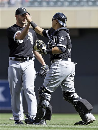 Chicago White Sox pitcher Brian Omogrosso, left, and catcher Hector Gimenez celebrate the White Sox' 9-4 win over the Minnesota Twins in a baseball game, Wednesday, May 15, 2013, in Minneapolis