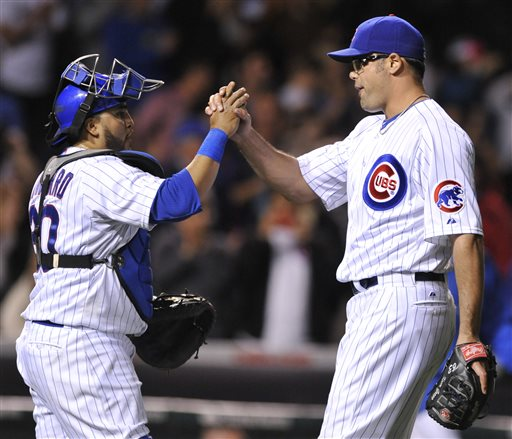 Chicago Cubs closing pitcher Kevin Gregg, right, celebrates with catcher Dioner Navarro left, after defeating the Colorado Rockies 6-3 in a baseball game in Chicago, Wednesday, May 15, 2013