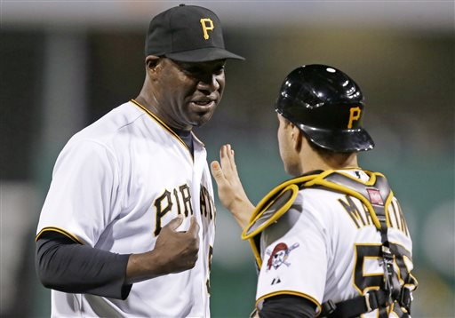 Pittsburgh Pirates pitcher Jose Contreras, left, celebrates with catcher Russell Martin after getting the final out of the PIrates' 7-1 win over the Milwaukee Brewers in a baseball game in Pittsburgh, Thursday, May 16, 2013