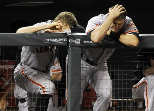 San Francisco Giants' Hunter Pence, left, and Brett Pill react during the ninth inning of a baseball game against the Colorado Rockies on Friday, May 17, 2013, in Denver. Colorado defeated San Francisco 10-9