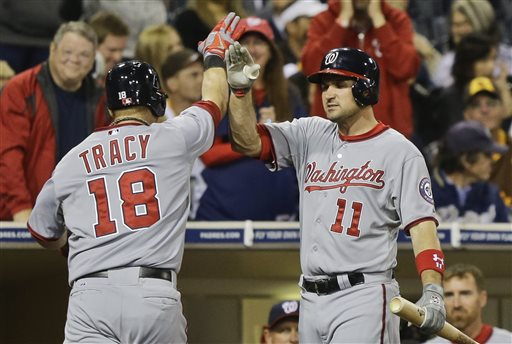 Washington Nationals' Chad Tracy high fives with Ryan Zimmerman after his tie breaking home run in the tenth inning gave the Nationals a 6-5 victory over the San Diego Padres in a baseball game in San Diego, Friday, May 17, 2013
