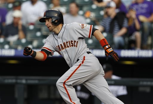 San Francisco Giants' Marco Scutaro breaks from the batter's box after singling against the Colorado Rockies in the first inning of a baseball game in Denver, Saturday, May 18, 2013