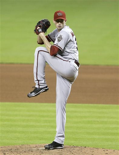 Arizona Diamondbacks' Brandon McCarthy delivers a pitch during the fourth inning of a baseball game against the Miami Marlins, Saturday, May 18, 2013 in Miami. McCarthy pitched a three-hit complete-game shutout for his first win since being struck in the head by a line drive last season in the Diamondbacks' 1-0 victory over the Marlins