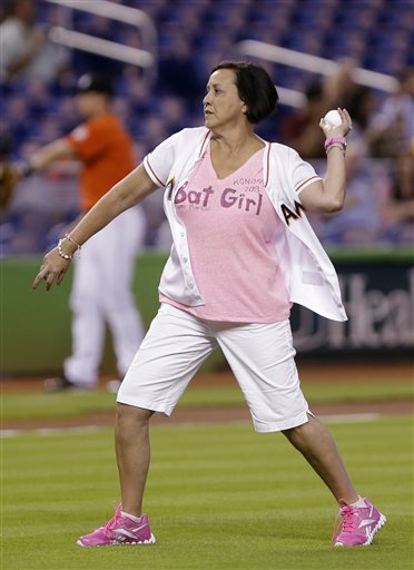 Honorary bat girl and breast cancer survivor  Ana Sanchez  throws out a ceremonial first pitch before the start of the MLB American National League baseball game between the Miami Marlins and the Arizona Diamondbacks Sunday, May 19, 2013, in Miami. Sanchez, who was diagnosed with breast cancer in 2010, and has undergone a partial mastectomy, chemotherapy and 33 rounds of radiation, was selected to represent the Marlins to raise awareness of breast cancer