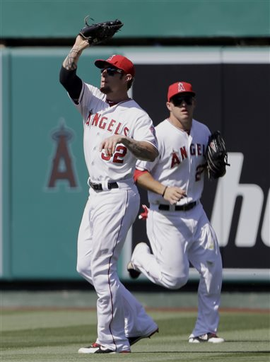 Los Angeles Angels right fielder Josh Hamilton (32) catches a fly off the Chicago White Sox' Alexei Ramirez as center fielder Mike Trout backstops, for the final out of baseball game in Anaheim, Calif., Sunday, May 19, 2013. The Angels won, 6-2