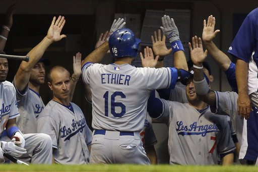 Los Angeles Dodgers' Andre Ethier is congratulated after hitting a home run during the fourth inning of a baseball game against the Milwaukee Brewers Monday, May 20, 2013, in Milwaukee