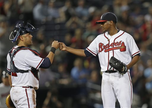 Atlanta Braves starting pitcher Julio Teheran (49) and Atlanta Braves catcher Gerald Laird (11) fist bump as Teheran leaves the game in the ninth inning of a baseball game against the Minnesota Twins Monday, May 20, 2013, in Atlanta. Atlanta won 5-1