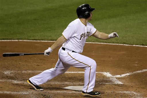 Pittsburgh Pirates' Travis Snider hits a grand slam off Chicago Cubs relief pitcher Shawn Camp during the sixth inning of a baseball game in Pittsburgh Tuesday, May 21, 2013