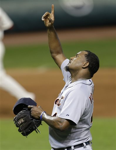 Detroit Tigers relief pitcher Jose Valverde points upward after the Tigers defeated the Cleveland Indians 5-1 in a baseball game, Tuesday, May 21, 2013, in Cleveland