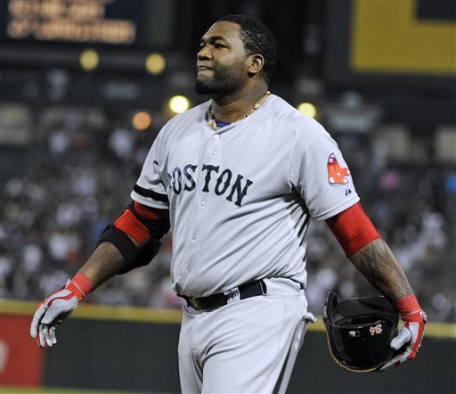 Boston Red Sox designated hitter David Ortiz  reacts after hitting into a double play against the Chicago White Sox during the eighth inning of a baseball game,Tuesday, May 21, 2013 in Chicago