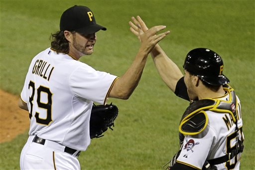 Pittsburgh Pirates closer Jason Grilli, left, celebrates with catcher Russell Martin after getting the final out of a 5-4 win over the Chicago Cubs in a baseball game in Pittsburgh Tuesday, May 21, 2013. Grilli got a major league leading 18th save