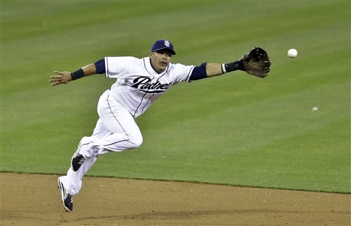 San Diego Padres shortstop Everth Cabrera can't reach an infield single by St. Louis Cardinals' Pete Kozma in the Cardinals' four run fifth inning in a baseball game in San Diego, Tuesday, May 21, 2013