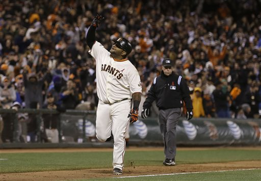 San Francisco Giants' Pablo Sandoval celebrates after hitting a two-run home run off of Washington Nationals pitcher Yunesky Maya during the tenth inning of a baseball game in San Francisco, Tuesday, May 21, 2013. The Giants won 4-2 in 10 innings