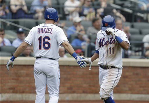 New York Mets' Rick Ankiel, left, greets Ruben Tejada after Tejada scored on a single by Daniel Murphy during the seventh inning of a baseball game against the Cincinnati Reds at Citi Field Wednesday, May 22, 2013, in New York