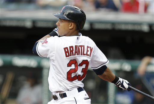 Cleveland Indians' Michael Brantley hits an RBI-single off Detroit Tigers starting pitcher Justin Verlander in the first inning of a baseball game on Wednesday, May 22, 2013, in Cleveland. Indians' Asdrubal Cabrera scored