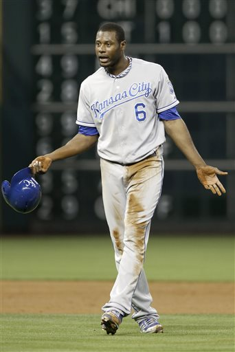 Kansas City Royals' Lorenzo Cain gestures to first base coach Rusty Kuntz after being caught trying to steal second base against the Houston Astros in the sixth inning of a baseball game on Wednesday, May 22, 2013, in Houston