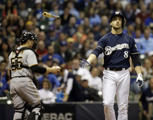 Pittsburgh Pirates catcher Russell Martin (55) walks back to the dugout as Milwaukee Brewers' Ryan Braun tosses his bat after striking out to end the third inning of a baseball game on Friday, May 24, 2013, in Milwaukee