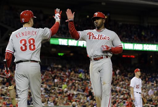 Philadelphia Phillies' Kyle Kendrick (38) celebrates with Domonic Brown after Brown scored during the fifth inning of a baseball game against the Washington Nationals at Nationals Park, Friday, May 24, 2013, in Washington
