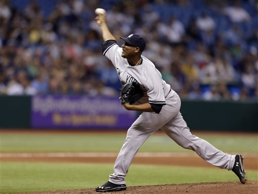 New York Yankees relief pitcher Ivan Nova delivers to the Tampa Bay Rays during the 10th inning of a baseball game on Saturday, May 25, 2013, in St. Petersburg, Fla. Nova picked up the win in the Yankees' 4-3, 11-inning win