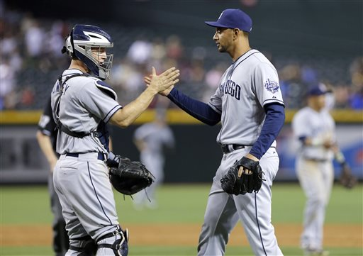 San Diego Padres' Nick Hundley, left, and Tyson Ross celebrate their win against the Arizona Diamondbacks after a baseball game, Saturday, May 25, 2013, in Phoenix