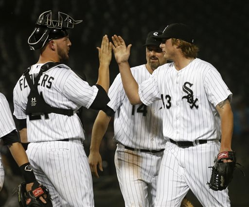 Chicago White Sox catcher Tyler Flowers, left, first baseman Paul Konerko (14) and relief pitcher Addison Reed celebrate the White Sox's 10-6 win over the Toronto Blue Jays after a baseball game Monday, June 10, 2013, in Chicago