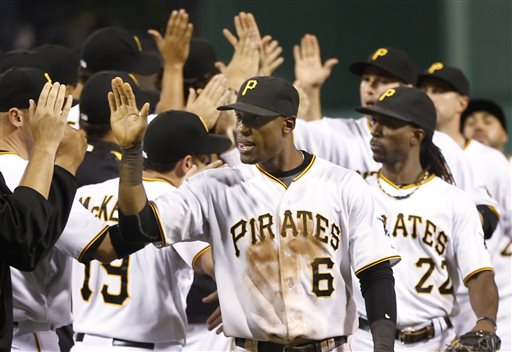 Pittsburgh Pirates' Starling Marte (6) and Andrew McCutchen (22) celebrate with the rest of the team after a baseball game against the San Francisco Giants, Wednesday, June 12, 2013, in Pittsburgh. The Pirates won 12-8