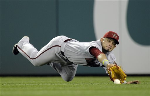 Arizona Diamondbacks right fielder Gerardo Parra is unable to catch a single by Washington Nationals' Adam LaRoche during the seventh inning of a baseball game at Nationals Park in Washington, Tuesday, June 25, 2013. The Nationals won 7-5