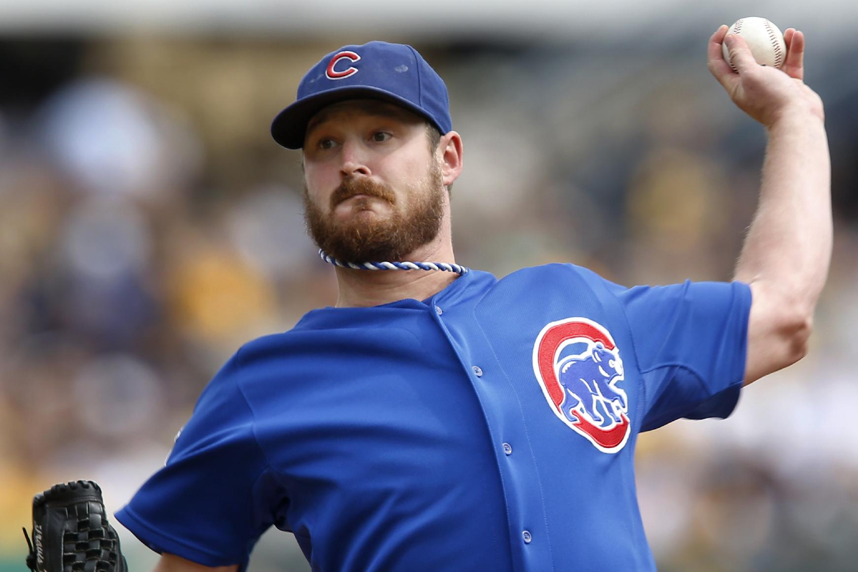 Chicago Cubs starting pitcher Travis Wood throws against the Pittsburgh Pirates in the first inning of a baseball game on Sunday, Sept. 15, 2013, in Pittsburgh