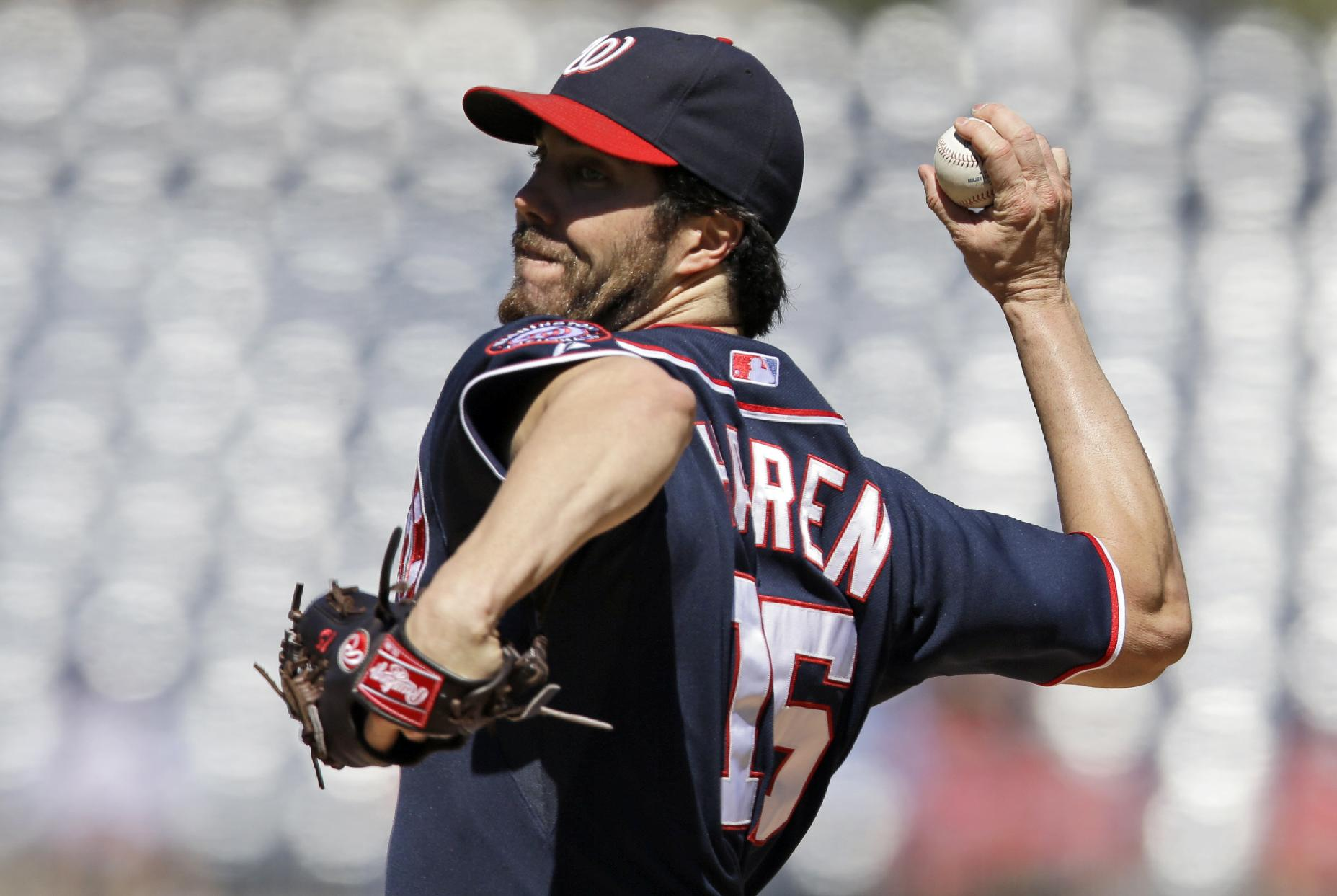 Washington Nationals starting pitcher Dan Haren throws  against the Atlanta Braves in the first inning of the first baseball game of a doubleheader at Nationals Park Tuesday, Sept. 17, 2013, in Washington
