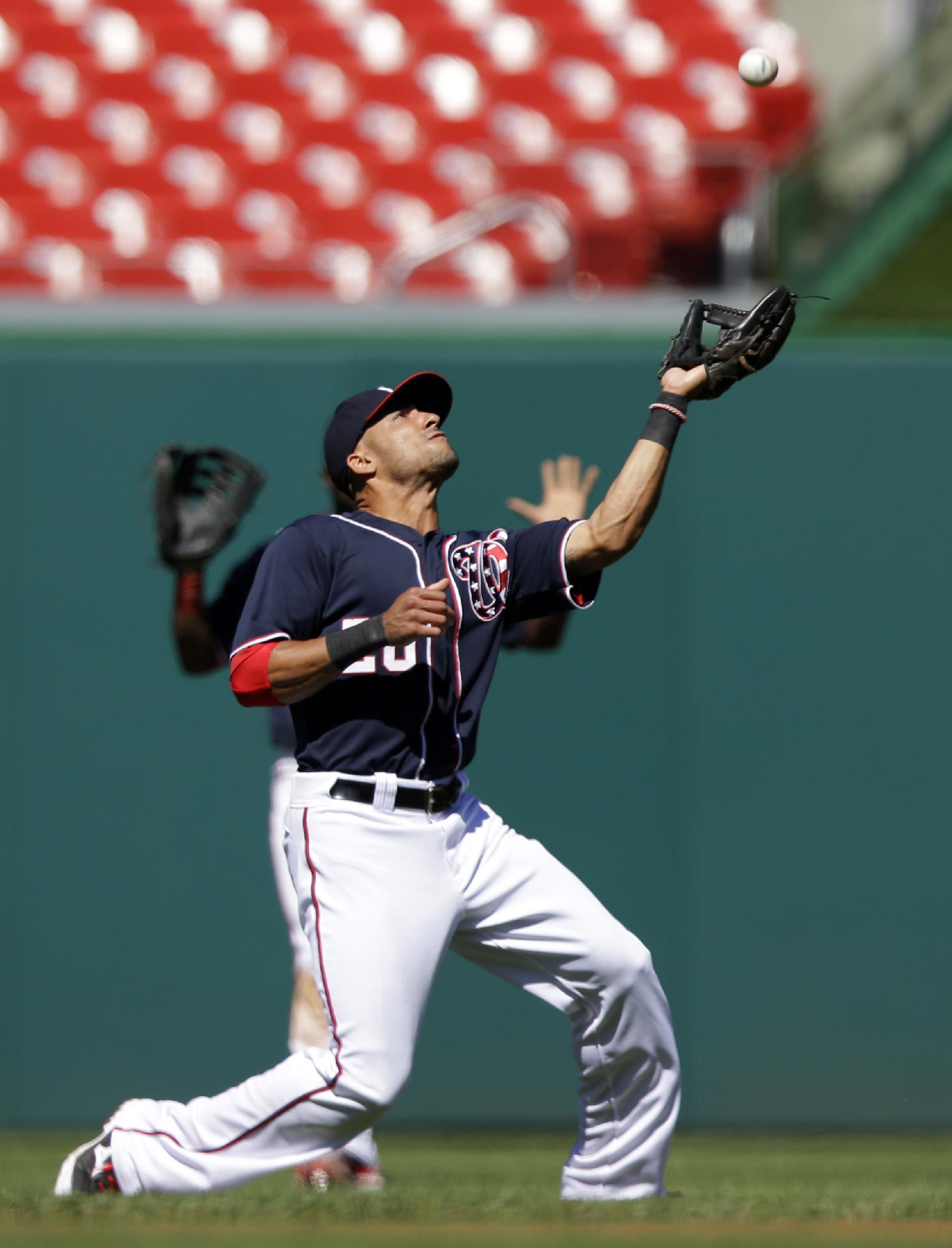 Washington Nationals shortstop Ian Desmond (20) catches a fly ball hit by Atlanta Braves' Brian McCann during the fourth inning of the first baseball game of a doubleheader at Nationals Park Tuesday, Sept. 17, 2013, in Washington