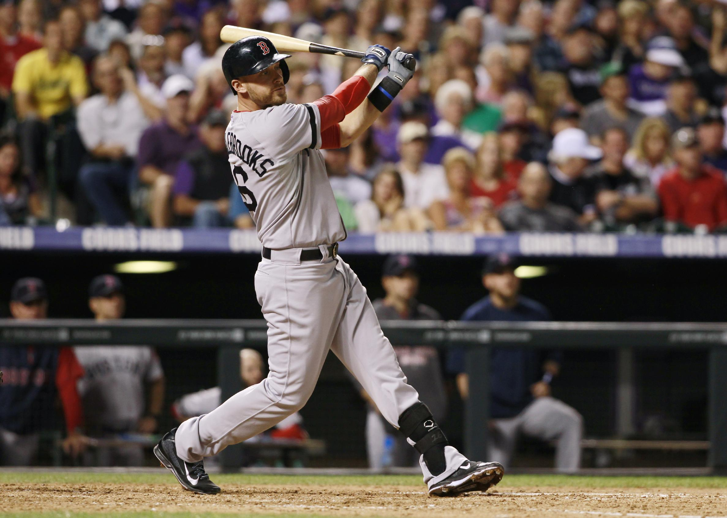 Boston Red Sox's Will Middlebrooks follows the flight of his three-run home run against the Colorado Rockies in the fifth inning of the Red Sox's 15-5 victory in a baseball game in Denver on Wednesday, Sept. 25, 2013