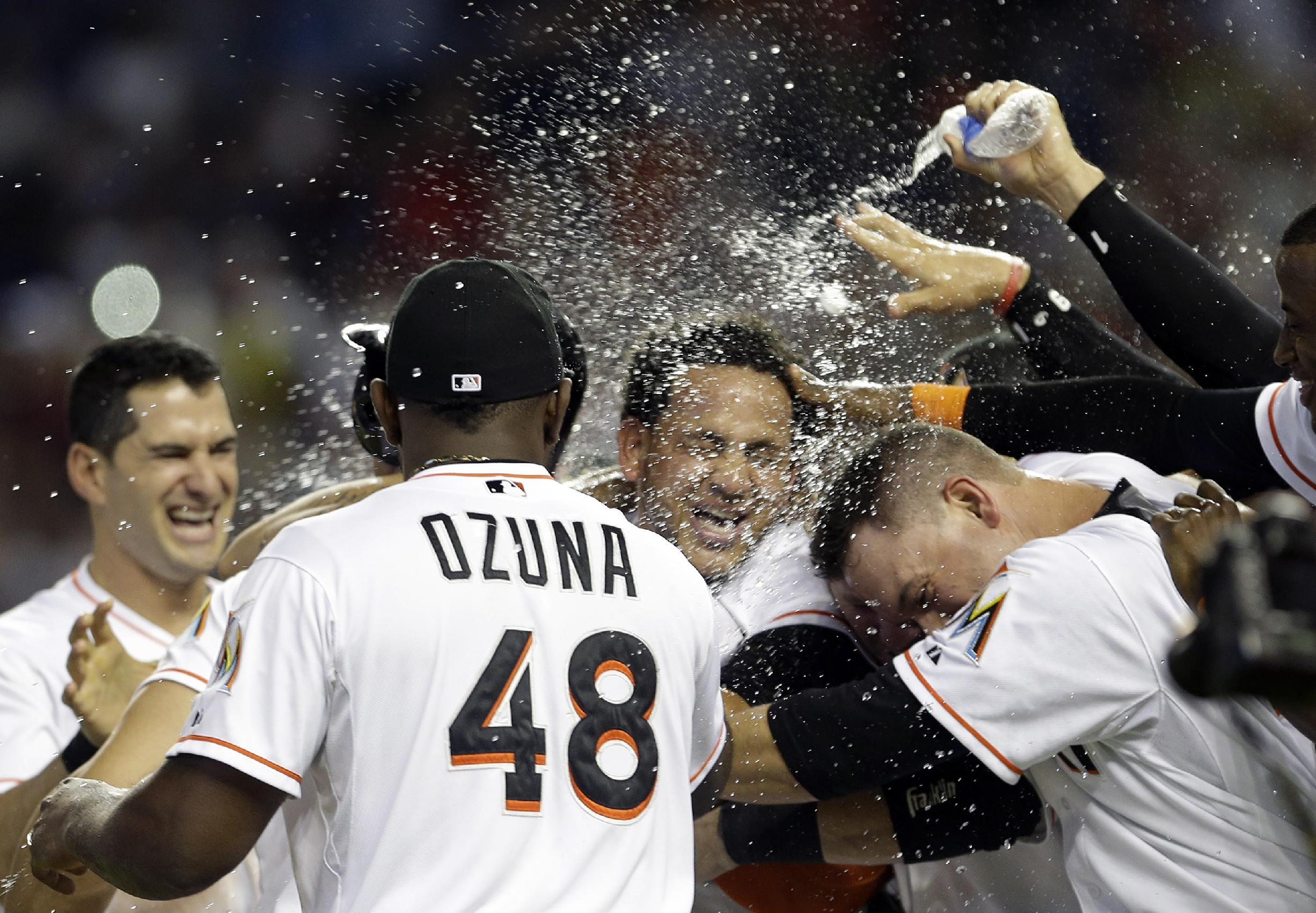 Henderson Alvarez celebrates with teammates after his no-hitter. (AP)