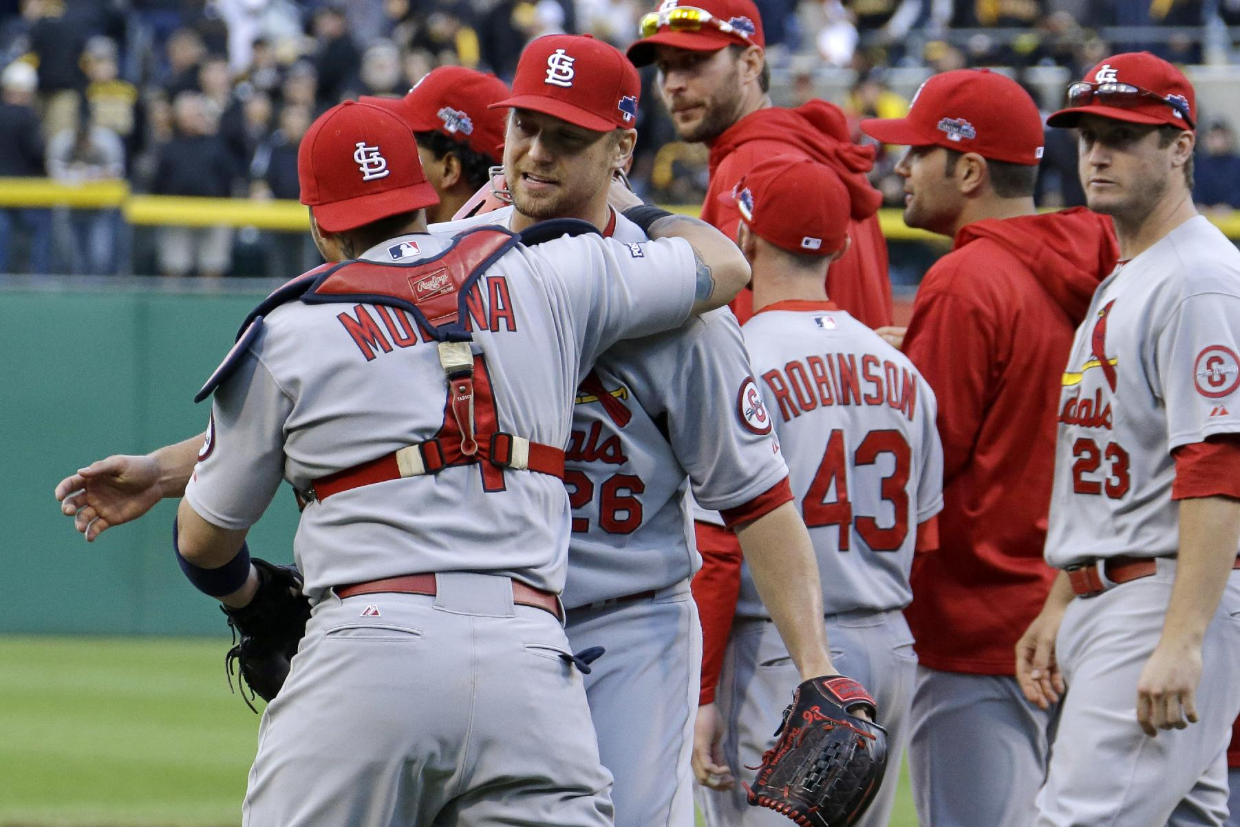 Closer Trevor Rosenthal celebrates with catcher Yadier Molina after getting the final out. (AP)