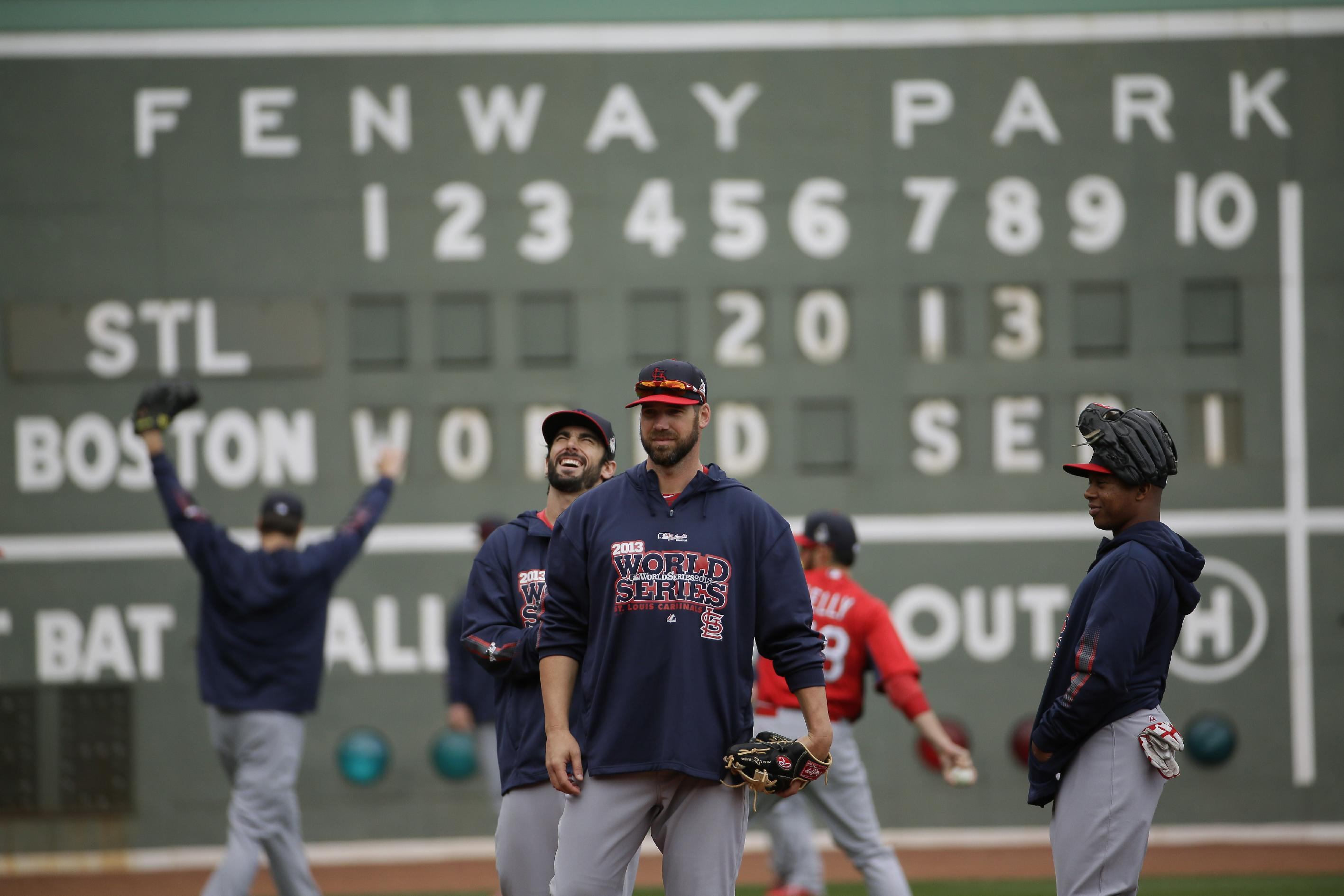 St. Louis Cardinals players warm up before batting practice for Game 1 of baseball's World Series against the Boston Red Sox Tuesday, Oct. 22, 2013, in Boston