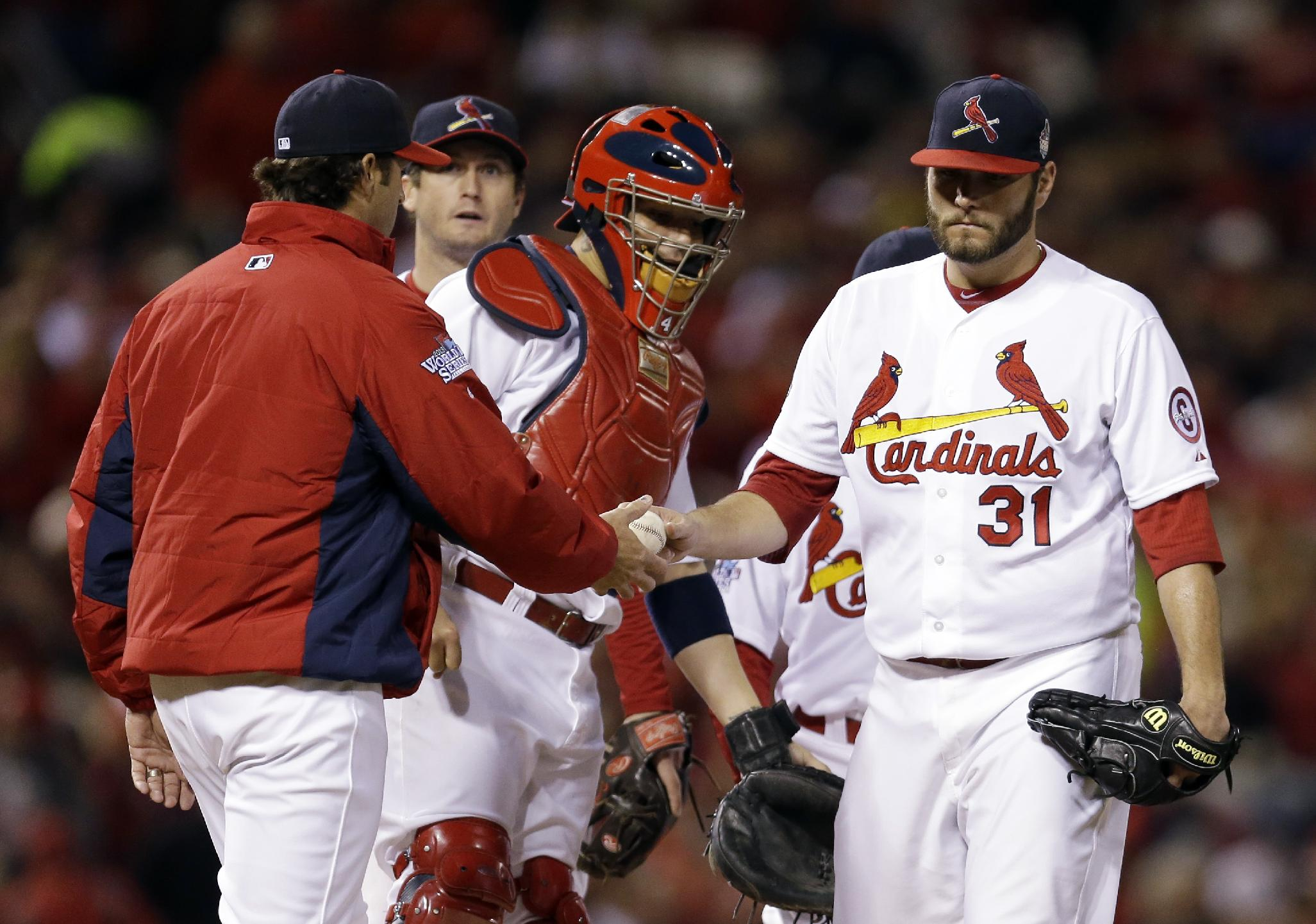St. Louis Cardinals manager Mike Matheny takes starting pitcher Lance Lynn out of the game during the sixth inning of Game 4 of baseball's World Series against the Boston Red Sox Sunday, Oct. 27, 2013, in St. Louis