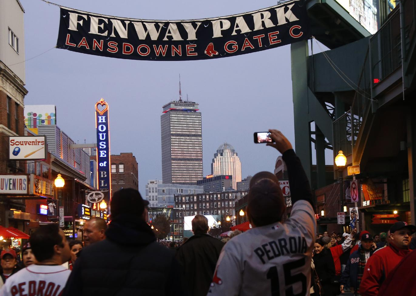 Fans shoot cell phone photos outside of Fenway Park before Game 6 of baseball's World Series Wednesday, Oct. 30, 2013, in Boston