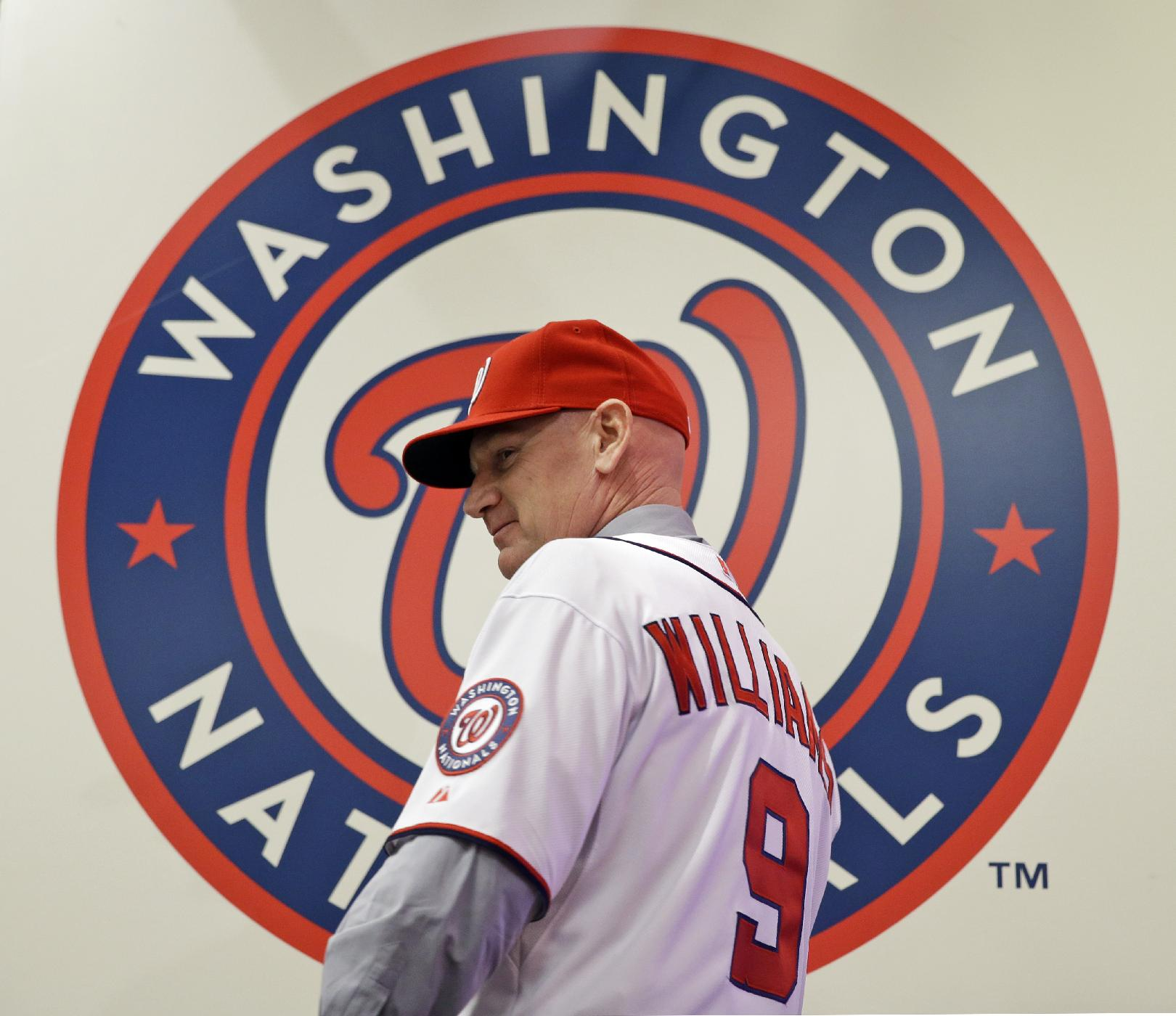 Matt Williams turns after showing the back of his newly-donned jersey, after he is introduced as the new manager of the Washington Nationals baseball team, during a news conference at Nationals Park, Friday, Nov. 1, 2013, in Washington