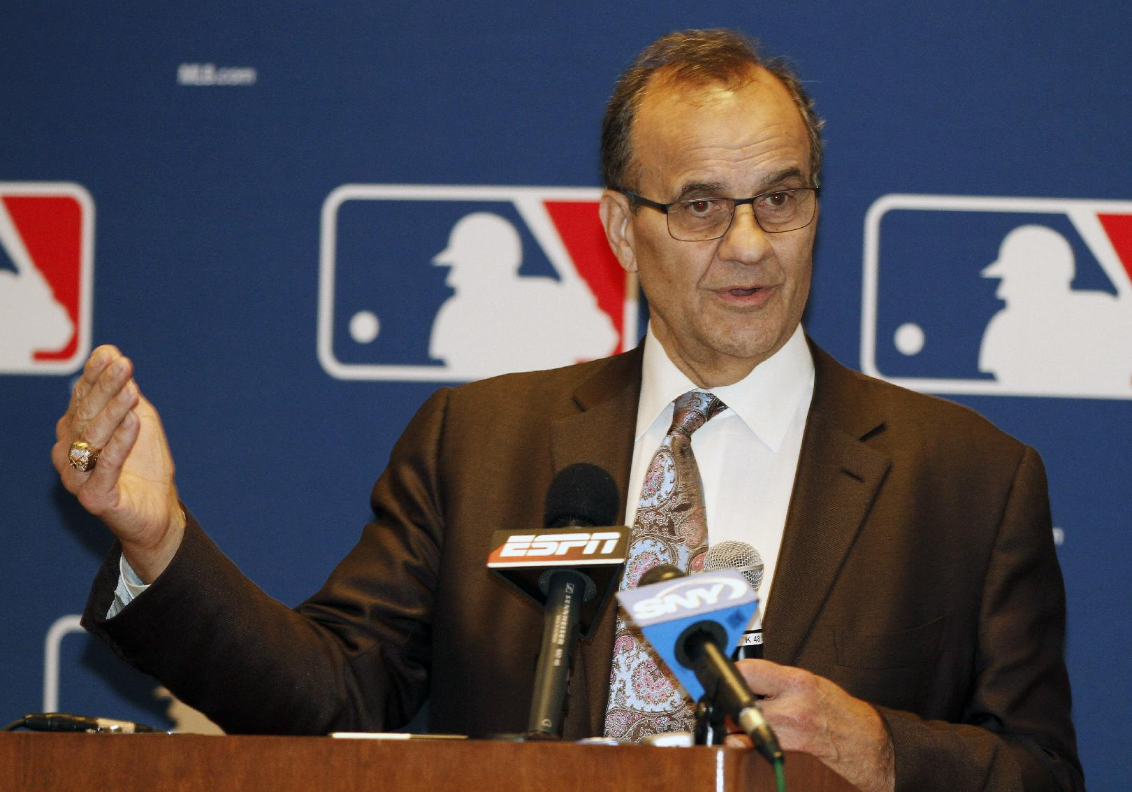 Major League Baseball executive Joe Torre talks with the media at the annual baseball general managers meeting, Tuesday, Nov. 12, 2013, in Orlando, Fla