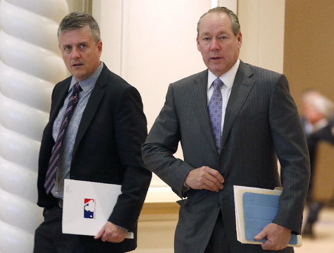 Houston Astros owner Jim Crane, right and general manager Jeff Lunhow head for morning meetings at baseball's general managers' meetings Thursday, Nov. 14, 2013, in Orlando, Fla